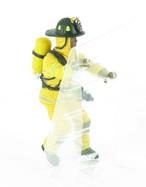 Pompier US jaune à l'échelle